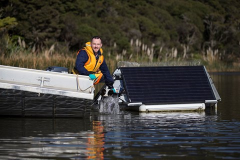 Sonic algae busters having their solar panels cleaned on Lower Nihotupu dam