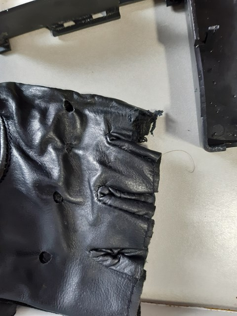 Glove with fingers chewed by mouse